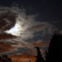 Sep 2009: Moon in Cloud© R. Wells